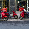 Pizza delivery scooters parked at roadside, Lisbon, Portugal
