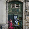 Graffiti on the door of typical house in Castelo, Lisbon, Portugal
