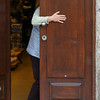 Person standing behind a door, Sao Nicolau, Porto, Portugal