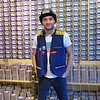 Man standing in front of stacks of food cans, Vitoria, Porto, Northern Portugal, Portugal