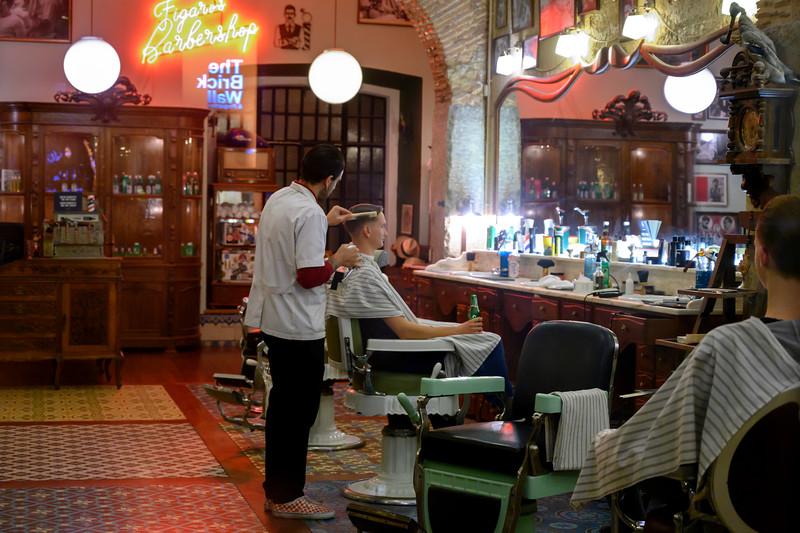Man getting haircut in barber shop, Sao Paulo, Lisbon, Portugal