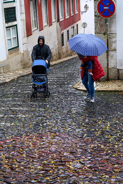 People on street with a stroller, Alfama, Sao Miguel, Lisbon, Portugal