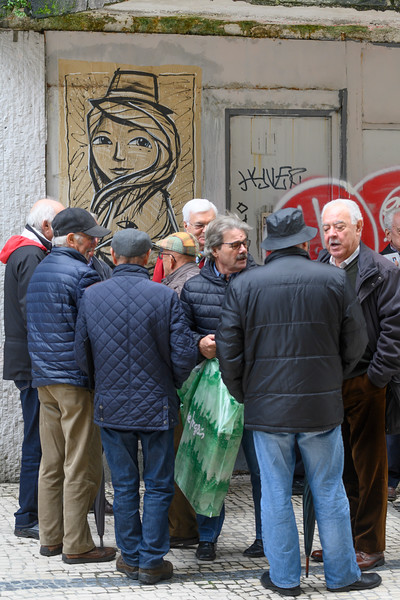 Group of people having a discussion on the road, Santo Ildefonso, Porto, Northern Portugal, Portugal