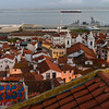 Buildings in city with ship in the background, Tagus River, Sao Miguel, Lisbon, Portugal
