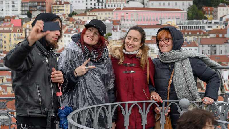 Tourists posing for selfie, Santa Justa Lift, Sao Nicolau, Lisbon, Portugal