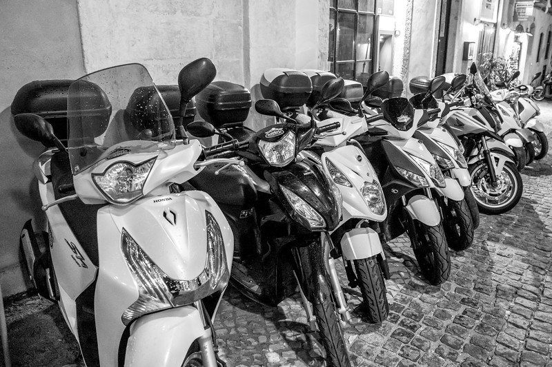 Motor scooters parked in a row at roadside, Encarnacao, Lisbon, Portugal