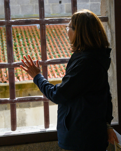 Woman looking through window, Portuguese Centre of Photography, Vitoria, Porto, Northern Portugal, Portugal