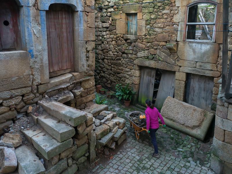 High angle view of woman pushing wheelbarrow, Jewish Quarter, Salzedas, Douro Valley, Viseu District, Portugal