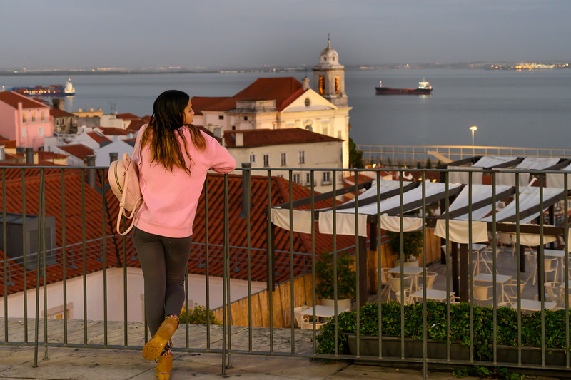 Woman looking at river view, Tagus River, Sao Miguel, Lisbon, Portugal