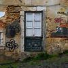 Closed door of old typical Portuguese house, Alfama, Santiago, Lisbon, Portugal