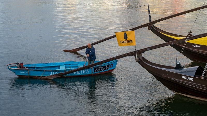 Man on a boat, Douro River, Porto, Northern Portugal, Portugal