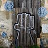 Graffiti on the door of damaged house in Santiago, Lisbon, Portugal