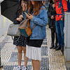 People on sidewalk during rain, Sao Nicolau, Lisbon, Portugal