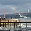 Pier on Tagus River with 25 de Abril Bridge in the background, Santa Maria de Belem, Lisbon, Portugal,