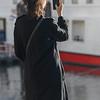 Woman taking photograph with mobile phone, Sao Nicolau, Porto, Portugal
