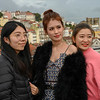 Female friends posing for camera, Sao Nicolau, Lisbon, Portugal