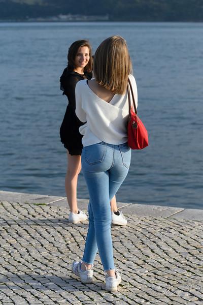 Woman taking picture of her friend, Alcantara, Lisbon, Setubal District, Portugal