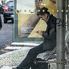 Man sitting at bus stop, Lisbon, Portugal