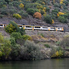 Tourist train moving along mountainside, Douro River, Douro Valley, Portugal