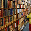 Man looking at books in library, Sacramento, Lisbon, Portugal