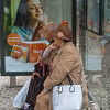 Elderly couple sitting at bus stop, Lisbon, Portugal