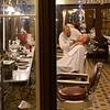 Barber shaving customer in barber shop, Martires, Lisbon, Portugal