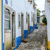 Houses along narrow street in a town, Obidos, Leiria District, Portugal