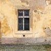 Window on a weathered wall, Prague, Czech Republic