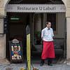 Waiter standing at the entrance to a restaurant, Prague, Czech Republic,