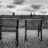 Chairs at Kampa Island with Charles Bridge in background, Prague, Czech Republic