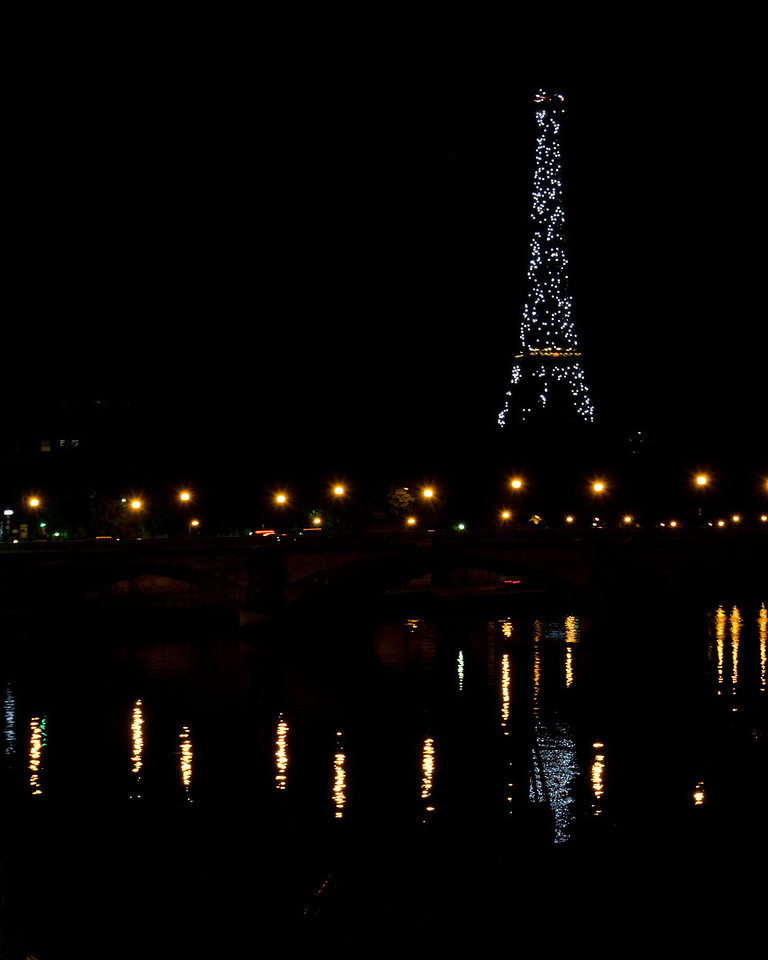 Eiffel Tower<br /> <br /> During the last light show of the night, only the strobes were flashing, so you just get an outline.  We had to walk back about 5km due to poor planning -- missed the last metro!<br /> <br /> Paris, France