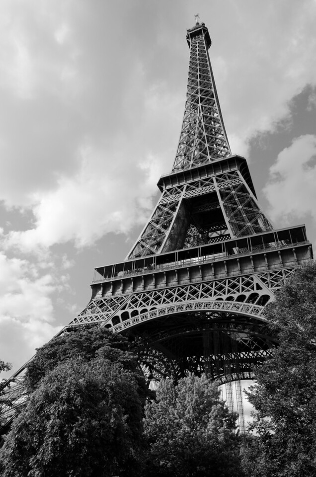 Le Tour<br /> <br /> Closer, more industrial view of the Eiffel tower gives a bit more scale to the image.  Truly massive and grand!<br /> <br /> Paris, France
