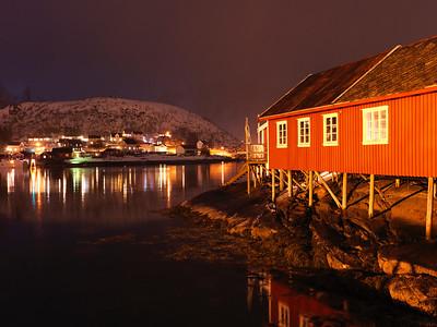 Fishing village lit up at night, Lofoten, Nordland, Norway