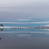 View of sea with mountain range in the background, Lofoten, Nordland, Norway
