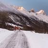 Snow covered road passing through mountain, Lofoten, Nordland, Norway