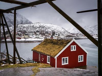 Village at waterfront with stilt hut at foreground, Lofoten, Nordland, Norway