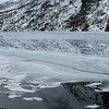 Reflection of mountain with ice floe floating on water, Lofoten, Nordland, Norway
