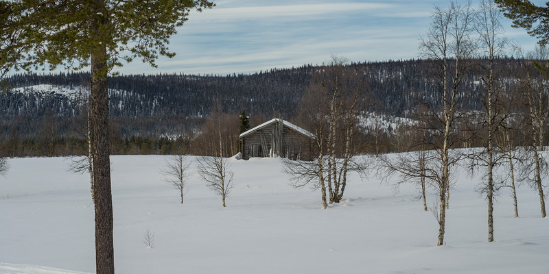 Wooden building on snow covered landscape, Arjeplog, Norrbotten County, Lapland, Sweden