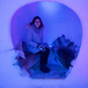 Woman sitting in an alcove in Icehotel, Norrbotten County, Lapland, Sweden