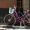 Bicycle locked to pipe at sidewalk, Gamla Stan, Stockholm, Sweden