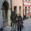 Elderly couple walking in street, Gamla Stan, Stockholm, Sweden