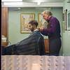 Barber cutting a man's hair, Gamla Stan, Stockholm, Sweden