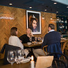 Three friends sitting in restaurant, Gamla Stan, Stockholm, Sweden