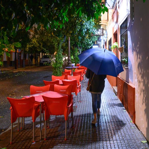Woman, walking by sidewalk caf� on the street in C�rdoba, C�rdoba Province, Spain