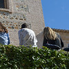 Back view of tourist sitting in a row in Alhambra, Granada, Granada Province, Spain