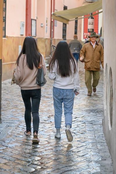 People walking on the street, San Bartolome, Seville, Seville Province, Spain