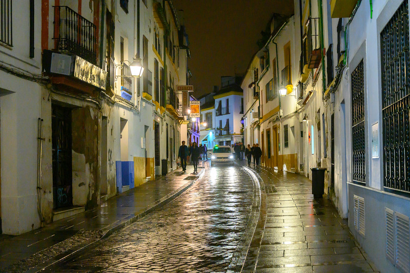 People walking in an alley at night, Cordoba, Andalusia, Spain
