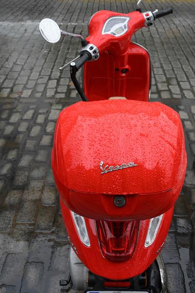 Raindrops on a motor scooter, Seville, Seville Province, Spain