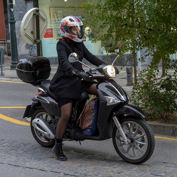 Woman riding motor scooter, Granada, Granada Province, Spain