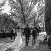 Bride and groom walking on cobblestone path in Alhambra, Granada, Granada Province, Spain